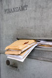 Tax office with overfilled mailbox at deadline for the tax return Royalty Free Stock Photo