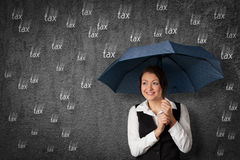 Tax optimization concept. Accountant woman get cute with tax. Sly businesswoman hide and protect herself under umbrella against raining tax. Tax optimization Royalty Free Stock Images