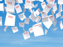 Tax papers flying. Tax papers falling on a cloud sky background Stock Image