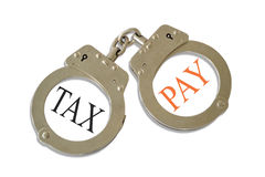 Tax Pay Handcuffs. Silver metalic handcuffs with a tax pay concept stock photos