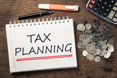 Tax Planning. As memo on notebook with coins and calculator royalty free stock images
