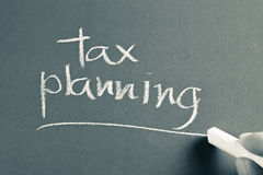 Tax planning. Hand writing Tax Planning word with chalk Royalty Free Stock Image