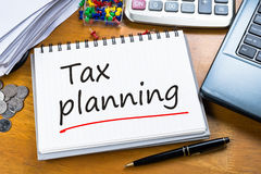 Tax Planning. Handwriting of Tax Planning as memo on working table Royalty Free Stock Photo