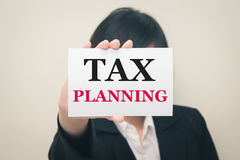 TAX PLANNING, message on the card Held by women Royalty Free Stock Image