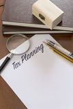 Tax Planning word written on paper. Royalty Free Stock Photos