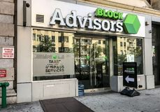 Tax preparation shop. New York, August 30, 2017: Entrance to a tax preparation shop called Block Advisors in Manhattan stock images