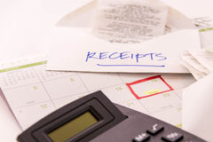 Tax preparation supplies and a calendar. With a red box around tax day, April 15 royalty free stock photo