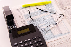 Tax preparation supplies, reading glasses and tax forms. Tax preparation supplies, reading glasses and blank tax forms royalty free stock images