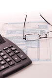 Tax preparation supplies, reading glasses and tax forms. Tax preparation supplies, reading glasses and blank tax forms stock photography