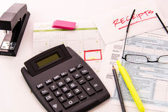 Tax preparation supplies, reading glasses and tax forms. Tax preparation supplies, reading glasses and blank tax forms royalty free stock image