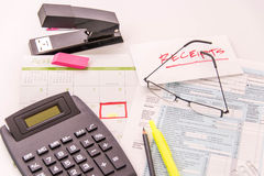 Tax preparation supplies, reading glasses and tax forms. Tax preparation supplies, reading glasses and blank tax forms royalty free stock photography