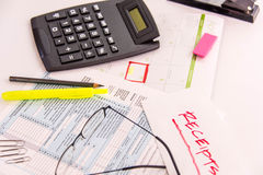 Tax preparation supplies, reading glasses and tax forms. Tax preparation supplies, reading glasses and blank tax forms royalty free stock photo