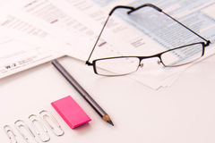 Tax preparation supplies, reading glasses and tax forms. Tax preparation supplies, reading glasses and blank tax forms stock image
