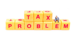 Tax problem. Man thinking about tax while siting on blocks royalty free stock photos