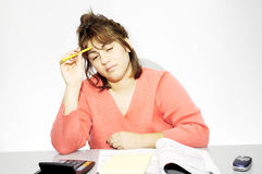 Tax Problems. Woman Sitting at her Desk With Paperwork and Claculator Stock Photos