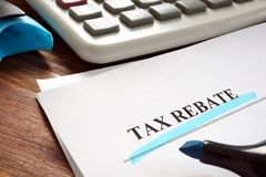 Free Tax Rebate Underlined Inscription On Documents Stock Images - 152600014
