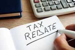 Free Tax Rebate Written By Hand And Money. Royalty Free Stock Image - 129178096