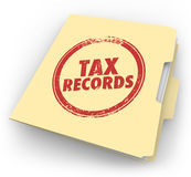 Tax Records Manila Folder Stamp Audit Documents FIle. Tax Records words stamped onto a manila folder to keep your documents in a file Royalty Free Stock Images