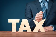 Tax reduction concept. Tax reduction business and financial concept. Angry businessman try to destroy text tax royalty free stock photo