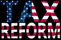 Tax reform letters on flag. Big, bold letters spelling tax reform with background of american flag Stock Photography