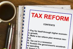 Tax reform plan concept. Complete with topics on a lecture cover sheet Stock Photos