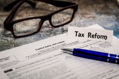 Tax Reform still life business finance concept, form 1099, with glasses stock image
