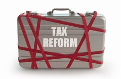 Tax reform. Printed on a briefcase tied with red tape stock photos