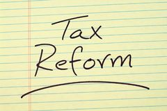 Tax Reform On A Yellow Legal Pad. The word `Tax Reform` underlined on a yellow legal pad Stock Image
