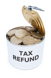 Tax refund. Tin can filled with coins labelled with tax refund Stock Images