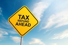 Tax refund ahead road sign with blue sky and cloud backgound royalty free stock photography