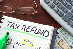 Tax refund. Notebook with tax refund  sign on a table. Business concept Royalty Free Stock Photos