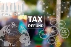 TAX REFUND on the touch screen with statistics on people blur background.Concept of TAX