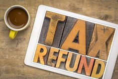 Tax refund word abstract in wood type stock images