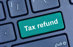 Tax refund words on computer keyboard Stock Photo