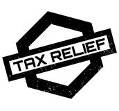 Tax Relief rubber stamp. Grunge design with dust scratches. Effects can be easily removed for a clean, crisp look. Color is easily changed Royalty Free Stock Photo