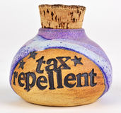 Tax repellent. Corked bottle labelled, tax repellent Stock Images
