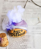 Tax repellent potion. Releasing tax repellent magical potion on top of a 1040 income tax form Stock Image