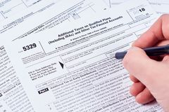 Human fills out the 5329 tax form royalty free stock photo