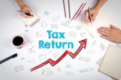 Tax return, Business Concept. The meeting at the white office table.  Royalty Free Stock Photography