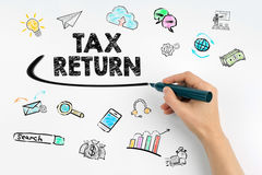 Tax return concept. Hand with marker writing.  Royalty Free Stock Image