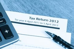 Tax return form 2012. Cool toned image of UK income tax return form for 2012 Royalty Free Stock Photography