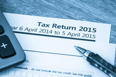 Tax return form 2015. Cool toned image of UK income tax return form for 2015 Royalty Free Stock Image