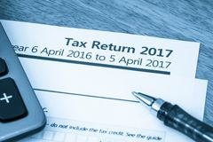 Tax return form 2017. Cool toned image of UK income tax return form for 2017 Royalty Free Stock Images