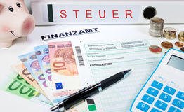 Tax return. Forms and calculator for tax revenue Royalty Free Stock Image