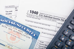 Tax return forms and documents. Tax return forms and Social Security Number card royalty free stock photography
