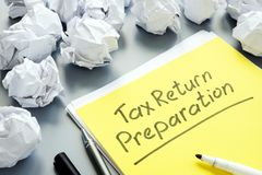 Tax Return Preparation concept and  papers. Tax Return Preparation concept and stack of papers stock images