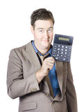 Tax return time. Accountant man holding calculator Stock Photography