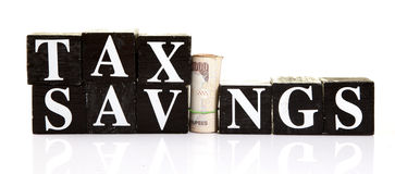 Tax savings. Concept image of tax savings over white background Stock Photos