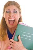Tax Scream Help!. Frightened middle aged woman terrified about completing her annual taxes for the American government of the I.R.S Royalty Free Stock Photo