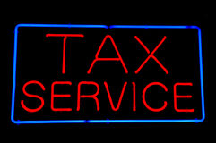 Tax Service Red Neon Sign Stock Photo